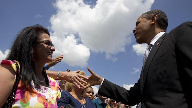 President Barack Obama greets people on the tarmac as he arrives at Palm Beach International Airport, Tuesday, April 10, 2012, in West Palm Beach, Fla. (AP Photo/Carolyn Kaster)