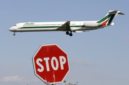 <p>An Alitalia passenger plane lands at Linate airport in Milan, Italy on September 22, 2008. Italian airline Alitalia is once more on the verge of bankruptcy as it loses 630,000 euros ($832,000) a day in addition to the 730 million euro deficit accumulated over four years under private ownership, the Repubblica daily said Friday.</p>
