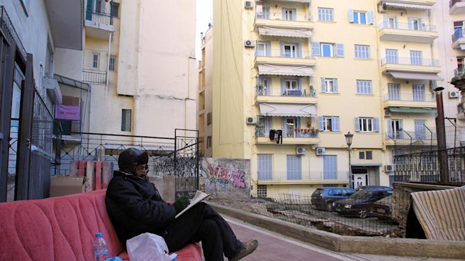 A homeless man sits on an old sofa on a pedestrian street in the northern port city of Thessaloniki , Greece, on Monday, Jan. 7, 2013. Greece has entered a sixth year of economic recession, and faces record high unemployment and homelessness rates as it struggles to tackle an acute financial crisis that has forced drastic cuts in state spending. (AP Photo/Nikolas Giakoumidis)