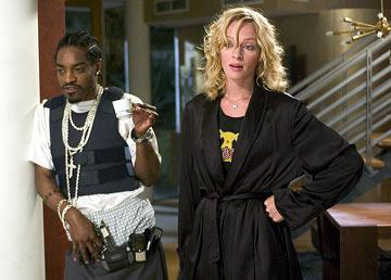 Andre Benjamin and Uma Thurman in MGM's Be Cool