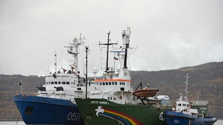 The Greenpeace ship 'Arctic Sunrise' (in green) is escorted into Murmansk harbour, on September 28, 2013