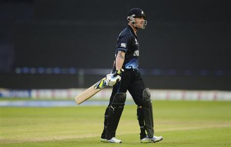 New Zealand's McCullum leaves the field after being dismissed during the ICC Champions Trophy group A match against England in Wales