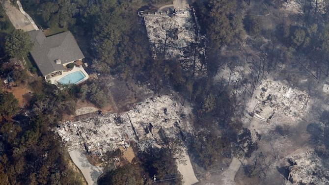 Homes destroyed by wildfire are seen Wednesday, Sept. 7, 2011, in Bastrop, Texas. The fire has destroyed more than 600 homes and blackened about 45 square miles in and around Bastrop. A search team on Wednesday will begin looking for more possible victims of the fire, which has killed two people and forced thousands to evacuate. (AP Photo/Eric Gay)