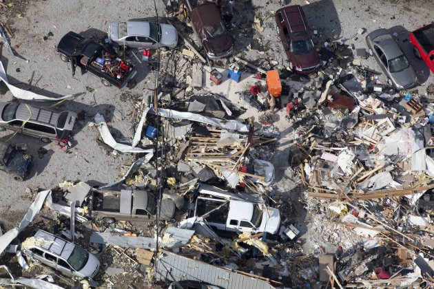 An aerial view shows wrecked cars amid debris in the wake of a tornado in Marysville, Indiana
