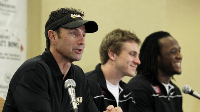 Southern Mississippi head coach Larry Fedora, left, addresses the media as quarterback Austin Davis, center, and linebacker Ronnie Thornton look on during an NCAA college football news conference in Honolulu, Tuesday, Dec. 20, 2011.  Southern Miss is scheduled to play Nevada in the Hawaii Bowl on Saturday. (AP Photo/Eric Risberg)