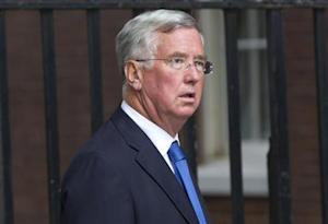 Conservative MP Michael Fallon arrives at Downing Street in London