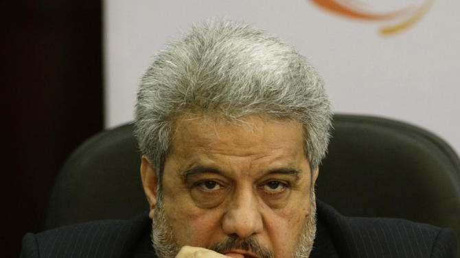 Iranian Ambassador to India Sayed Mehdi Nabizadeh listens as Iranian Energy Minister Majid Namjoo unseen, speaks during an interactive business meeting with Federation of Indian Chambers of Commerce and Industry members in New Delhi, India, Wednesday, Oct. 10, 2012. (AP Photo/Altaf Qadri)