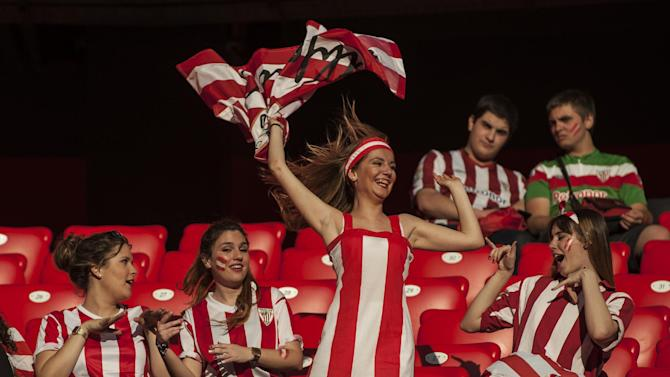 A supporter of Athletic Bilbao waves a team flag before the Spanish Copa del Rey final soccer match between Athletic Bilbao and  FC Barcelona at San Mames stadium, Bilbao, northern Spain, Saturday, May 30, 2015. San Mames stadium is the point where  thousands of Athletic Bilbao supporters will gather to see the match. (AP Photo/Alvaro Barrientos)