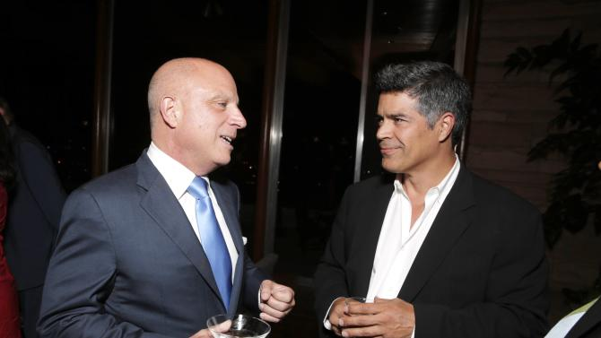 """Starz CEO Chris Albrecht, left, and Esai Morales attend the """"Magic City"""" season 2 premiere after party on Monday, June 3, 2013, in Los Angeles. (Photo by Todd Williamson/Invision for Starz/AP Images)"""