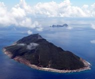 View of the disputed islands -- known as Senkaku in Japan and Diaoyu in China -- in the East China Sea. Four Chinese government ships spent several hours in territorial waters around disputed Tokyo-controlled islands, for what Japan's coastguard said was the first time in three weeks