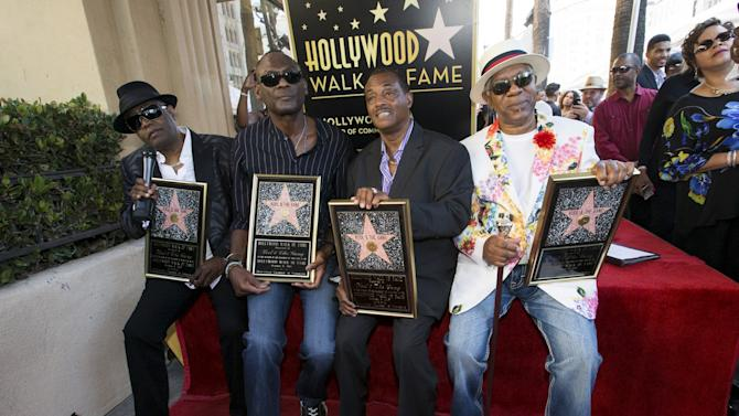"Music group ""Kool & the Gang"", ""Kool"" Bell, Brown, Bell and Thomas pose after unveiling their star on the Hollywood Walk of Fame in Los Angeles"
