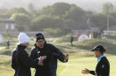 Suzann Pettersen, left, and Christie Kerr, right, talk to a rules official about the suspension of play during day two of the Women's British Open at the Royal Liverpool Golf Course, in Hoylake, England, Friday Sept. 14, 2012. Play was suspended after about an hour of play because of strong winds that disrupted the second round so badly that organizers declared early scores
