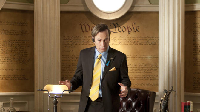 "This image released by AMC shows Bob Odenkirk portraying attorney Saul Goodman in a scene from the fourth season of ""Breaking Bad."" As he boasts in his commercial on local TV, ""from parking tickets to mass murder, from slip-and-fall to bond fraud, Saul Goodman and Associates is your one-stop shop for all your legal needs."" (AP Photo/AMC, Ursula Coyote)"