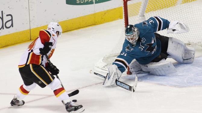Pavelski leads Sharks past Flames 3-2