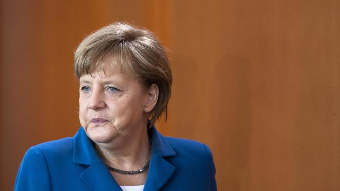 """German Chancellor Angela Merkel arrives at the weekly cabinet meeting to discuss the country's budget 2013 at the chancellery in Berlin, Wednesday, June 27, 2012. German Chancellor Angela Merkel on Tuesday told a caucus meeting that there won't be a full shared debt liability in Europe """"as long as I live,"""" according to a lawmaker from Merkel's governing coalition. (AP Photo/Markus Schreiber)"""