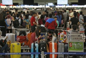 Passengers whose travel plans were affected by Typhoon…