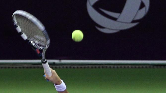 Agnieszka Radwanska of Poland returns the ball to Belarus' Victoria Azarenka in the Semifinal of the WTA Qatar Ladies Open tennis tournament in Doha, Qatar, Saturday, Feb. 16, 2013. (AP Photo/Osama Faisal)