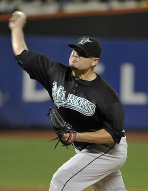 Florida Marlins starting pitcher Ricky Nolasco throws to the New York Mets in the second inning of the second baseball game of a doubleheader on Monday, Aug. 29, 2011, in New York. (AP Photo/Kathy Kmonicek)