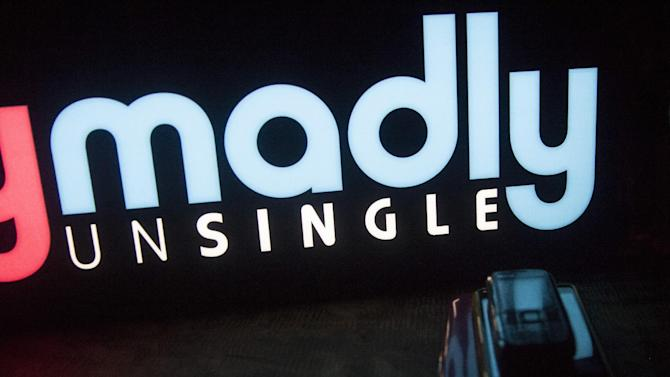 """In this June 11, 2015 photo, a signage of """"TrulyMadly,"""" one of India's online dating apps, is displayed at a party hosted by them in Gurgaon, India. Hundreds of thousands of young Indians are nervously exploring online dating apps, breaking with India's centuries-old traditions governing marriage and social conduct. The dating app market has exploded in recent years, with more than a dozen companies operating in the country and more than a million smartphone users who have downloaded at least one of them. (AP Photo/Tsering Topgyal)"""