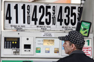 <p>               In this March 2, 2012 photo, Al Milani of Staten Island, pumps gas in Manhattan at a BP mini-mart. Higher gas costs drove U.S. wholesale prices up last month. But excluding the big jump in gas, inflation was mostly tame. (AP Photo/Gene J. Puskar)