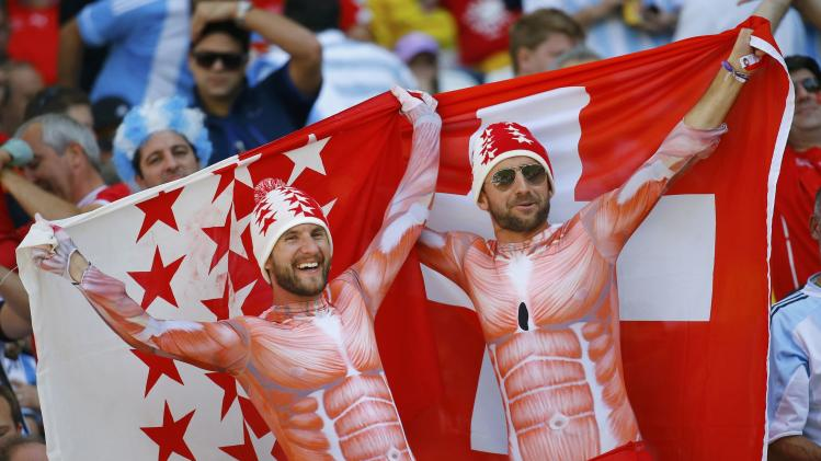 Switzerland fans cheer before the 2014 World Cup round of 16 game between Argentina and Switzerland at the Corinthians arena