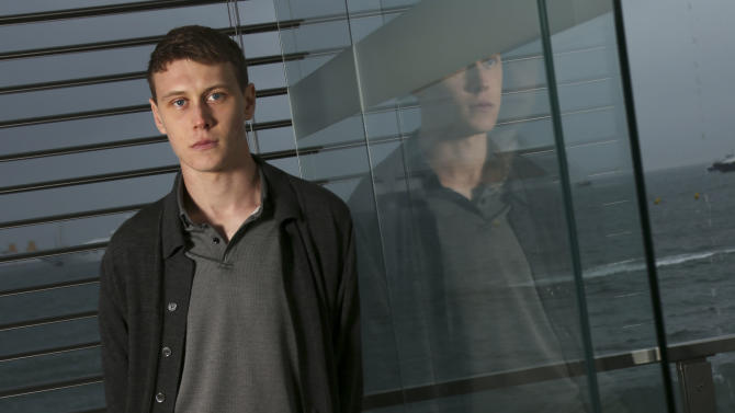 "Actor George Mackay poses during a portrait session for the film For Those in Peril at the 66th international film festival, in Cannes, southern France, Saturday, May 18, 2013. Young British actor George MacKay is making a splash at Cannes, literally, amid the weekend's torrential downpours, with his compelling lead role in the Scottish drama ""For Those In Peril."" (Photo by Joel Ryan/Invision/AP)"