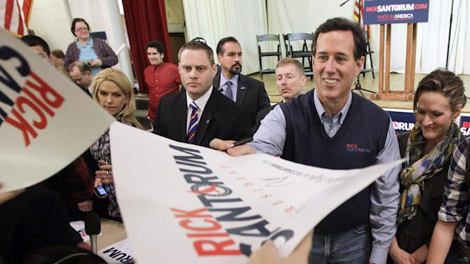 Republican presidential candidate, former Pennsylvania Sen. Rick Santorum and his wife Karen, right, visit with attendees at the American Legion, Monday, March 5, 2012, in Westerville, Ohio.  (AP Photo/Eric Gay)
