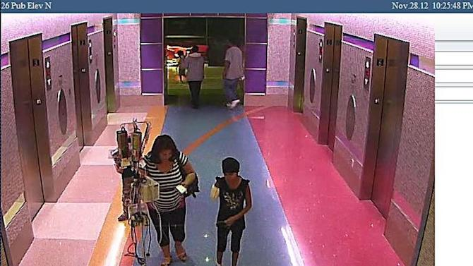 FILE - In this file hospital surveillance photo released by the Phoenix Police Department on Monday, Dec. 3, 2012, Norma Bracamontes escorts her 11-year-old daughter, Emily, a leukemia patient who had her arm amputated and a heart catheter inserted due to an infection, out of Phoenix Children's Hospital on Nov. 28, 2012. Bracamontes has a history of removing her daughter from medical facilities against the advice of doctors, police said Wednesday, Dec. 12, 2012 as the parents claimed the girl was being treated in Mexico. (AP Photo/Phoenix Police Department, File)