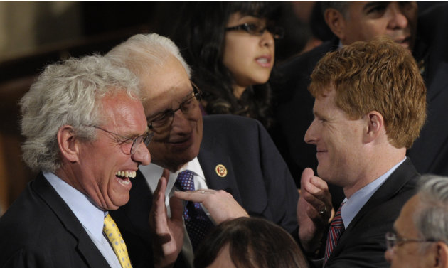 Rep.-elect Joseph P. Kennedy III, D-Mass., grandson of Robert F. Kennedy, right, talks with his father Joseph P. Kennedy II, left, and Rep. Bill Pascrell, Jr., D-N.J., center, as he waits to be sworn