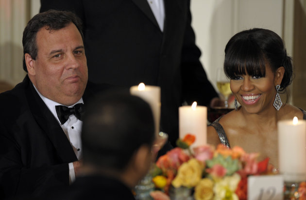 New Jersey Gov. Chris Christie sits next to first lady Michelle Obama as President Barack Obama welcomed the governors of the National Governors Association to the 2013 Governors Dinner at the White House in Washington, Sunday, Feb. 24, 2013. (AP Photo/Susan Walsh)