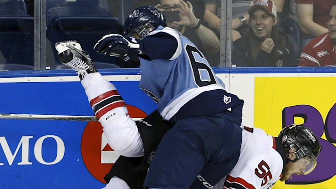Quebec Remparts' Matt Murphy collides with Rimouski Oceanics' Francois Beauchemin during third period of Memorial Cup hockey game at the Colisee Pepsi in Quebec City