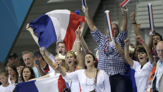French supporters cheer on their men's 4X100 meter freestyle relay final team at the Aquatics Centre in the Olympic Park during the 2012 Summer Olympics in London, Sunday, July 29, 2012. (AP Photo/Lee Jin-man)