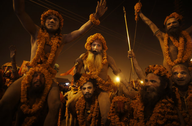 """Naga"" sadhus or Hindu naked holy men from the Niranjani ""Akhada"" or sect, take out a procession to take a ritual dip at ""Sangam,"" the confluence of Hindu holy rivers Ganges, Yamuna and the mythical S"
