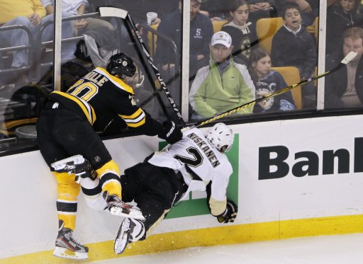 Bruins Paille checks Penguins Niskanen during the second period of their NHL hockey game at TD Garden in Boston