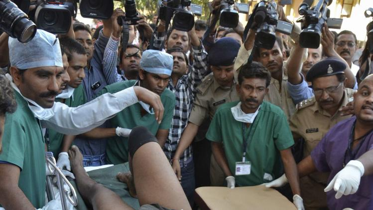 An injured Indian CRPF personnel is taken to a hospital at Raipur