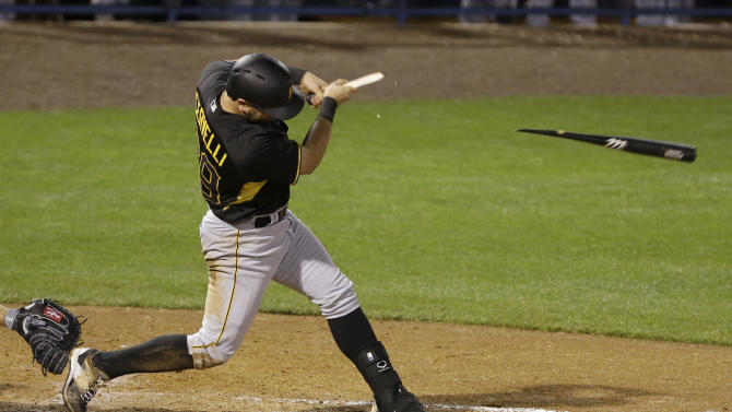 Pittsburgh Pirates' Francisco Cervelli breaks his bat in the fifth inning during a spring training baseball game against the New York Yankees, Friday, March 6, 2015, in Tampa, Fla. (AP Photo/Lynne Sladky)