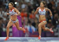 Britain's Jessica Ennis (L) and Britain's Katarina Johnson-Thompson (R) compete in the women's heptathlon 200m heats at the athletics event during the London 2012 Olympic Games on August 3, 2012 in London