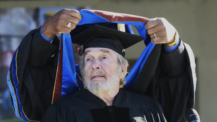 Country music legend Merle Haggard receives an Honorary Doctorate at the 2013 Arts and Humanities Commencement ceremonies at California State University, Bakersfield on Friday June 14, 2013. (AP photo/The Bakersfield Californian, Felix Adamo)