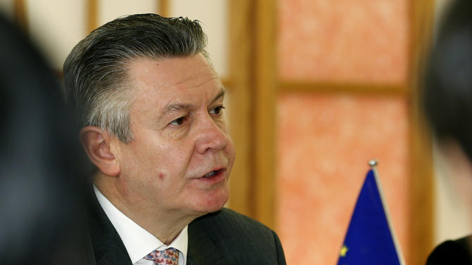 European Trade Commissioner Karel De Gucht speaks to Japanese Foreign Minister Fumio Kishida at Japan's Foreign Ministry in Tokyo, Monday, March 25, 2013. Japan's prime minister will discuss a possible free trade pact with the European Union even as a summit in Tokyo to launch the negotiations is postponed because of the financial crisis in Cyprus. De Gucht is in Tokyo and meeting with Japanese government and business officials as scheduled. (AP Photo/Shizuo Kambayashi)