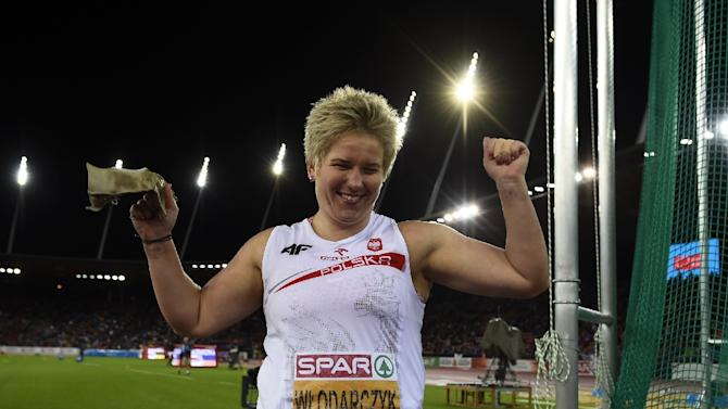Poland's Anita Wlodarczyk celebrates after winning the Women's Hammer Throw final during the European Athletics Championships at the Letzigrund stadium in Zurich on August 15, 2014