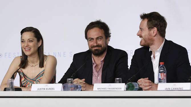 From left, actress Marion Cotillard, director Justin Kurzel and actor Michael Fassbender attend a press conference for the film Macbeth at the 68th international film festival, Cannes, southern France, Saturday, May 23, 2015. (AP Photo/Thibault Camus)