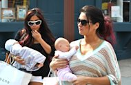 Nicole 'Snooki' Polizzi and Jenni 'JWoww' Farley cradle their baby dolls, seen on location for 'Snooki and JWoww vs. the World' in Jersey City, NJ, on March 23, 2012 -- Getty Premium