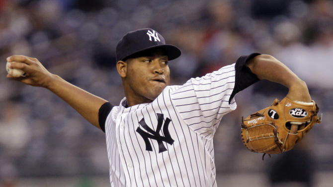 New York Yankees starting pitcher Ivan Nova winds up in the first inning against the Tampa Bay Rays during their baseball game at Yankee Stadium in New York, Tuesday, May 8, 2012.  (AP Photo/Kathy Willens)