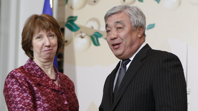 EU foreign policy chief Catherine Ashton, left, and Kazakhstan's Foreign Minister Yerlan Idrisov pose for the press in Almaty, largest Kazakhstan's city on Friday, April 5, 2013 at a start of high-level talks between world powers and Iranian officials. (AP Photo/ Shamil Zhumatov, Pool)