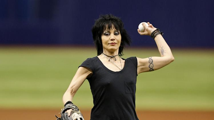 Musician Joan Jett throws out the first pitch prior to a baseball game between the Toronto Blue Jays and Tampa Bay Rays Saturday, July 12, 2014, in St. Petersburg, Fla. (AP Photo/Mike Carlson)