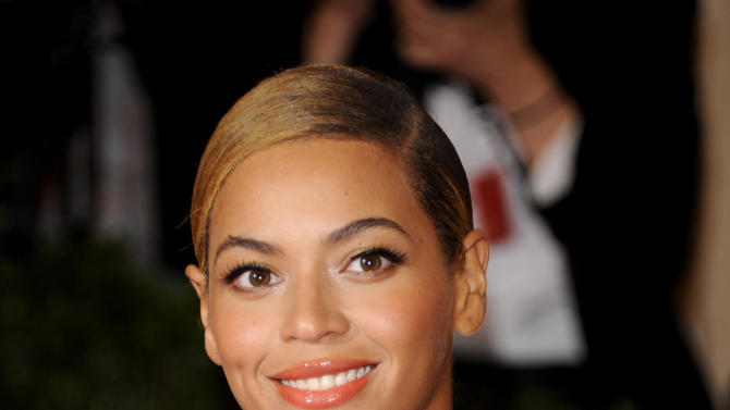 FILE - This May 7, 2012 file photo shows Beyonce Knowles at the Metropolitan Museum of Art Costume Institute gala benefit, celebrating Elsa Schiaparelli and Miuccia Prada in New York. A source familiar with Super Bowl XLVII told The Associated Press that the Grammy-winning diva will take the stage at the Pepsi NFL Halftime Show on Feb. 3, 2013 at the Mercedes-Benz Superdome in New Orleans, La.  (AP Photo/Evan Agostini, file)