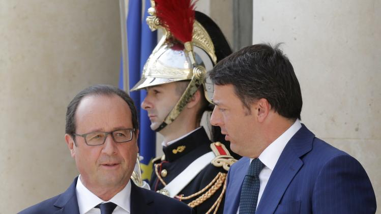 French President Hollande welcomes Italy's Prime Minister Renzi before a meeting with European Socialist leaders at the Elysee Palace in Paris