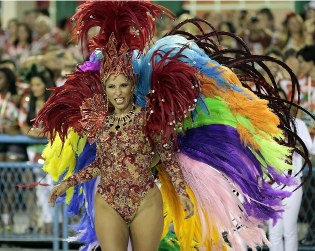 Drum queen Patricia Nery of the Renascer de Jacarepagua samba school dances on the first night of the annual Carnival parade in Rio de Janeiro's Sambadrome