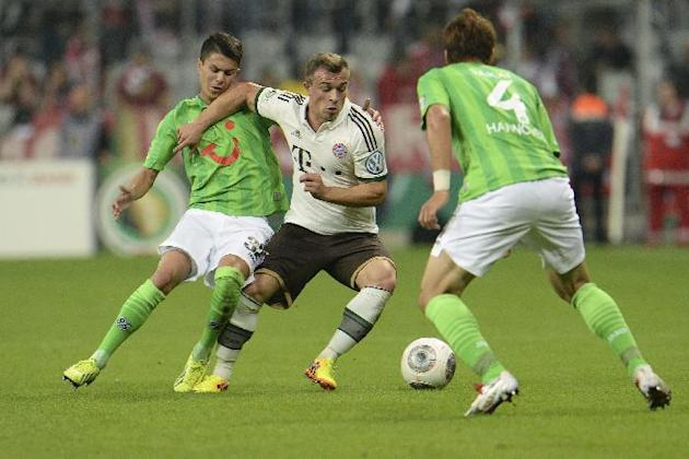 Munich's Xherdan Shaqiri of Switzerland, center, challenges for the ball with Hannover's Leonardo Bittencourt, left, and Hiroki Sakai of Japan during the German soccer cup second round match between F