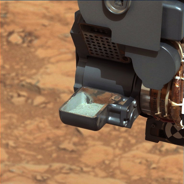 The first sample of powdered rock from Mars extracted by the NASA's Curiosity rover drill is pictured in this NASA handout photo